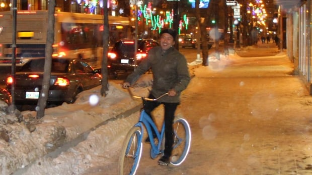 Downtown BIZ managing director Jason Syvixay takes a spin on Winnipeg's wintery streets in advance of Moveable Feast, a biking tour of area restaurants Feb.13. The tour coincides with the Winter Cycling Congress, a international conference of winter biking enthusiasts, urban planners and policy makers being held in Winnipeg.
