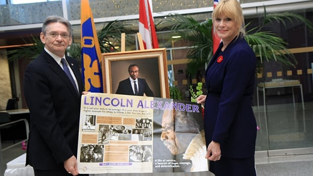 David Christopherson and Marnie Alexander show off a poster that was sent to 3,000 Ontario public schools to commemorate Lincoln Alexander Day on Tuesday. Both hope the federal government will proclaim a national Lincoln Alexander Day.