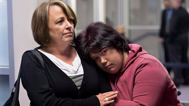 Nichele Benn, right, and her mother Brenda Hardiman wait at provincial court in Dartmouth in January. Hardiman says her daughter has cerebral palsy, epilepsy and an organic brain disorder that causes periodic episodes of aggressive behaviour.