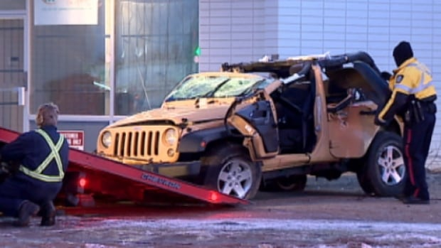 A 28-year-old man died on Jan. 22 after this Jeep crashed into a building on Gateway Boulevard in Edmonton. Another 28-year-old man now faces charges including impaired driving causing death.