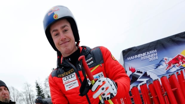 Canada's Erik Guay smiles Thursday while inspecting the course at Kitzbuehel, but he won't be competing at the legendary mountain this weekend.