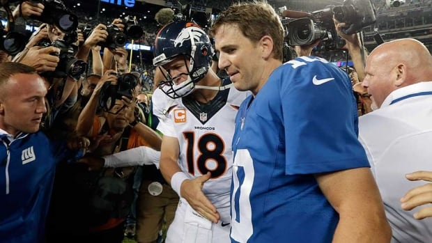 Denver Broncos quarterback Peyton Manning, left, may look to brother Eli for some advice on how to take on the Seattle Seahawks' stingy defence in the Super Bowl.