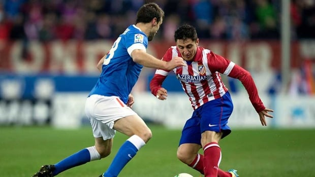 Cristian Rodriguez alias El Cebolla, right, of Atletico de Madrid competes for the ball with Carlos Gurpegi, left, of Athletic Club during the Copa del Rey quarter-final first leg match at Vicente Calderon Stadium on Thursday in Madrid, Spain.