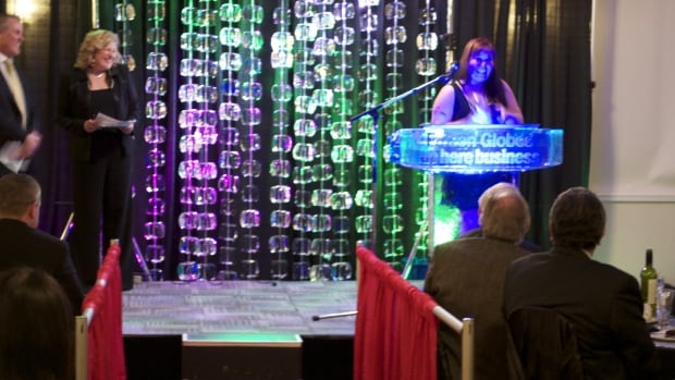The CBC's Sandi Coleman, host of A New Day in Whitehorse, looks on as Sadie Vincent-Wolfe, owner of the I Like Cake bakery in Iqaluit, accepts the award for Best New Business. The 2014 Frozen Globe Awards gala was held in Whitehorse last night.