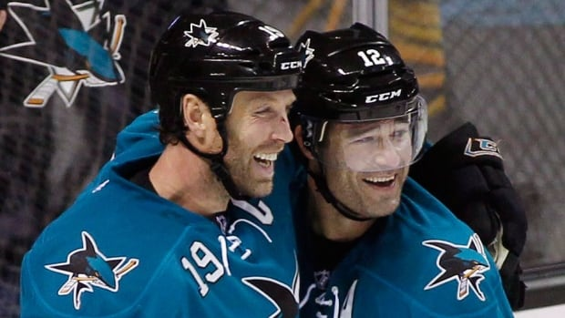 The Sharks have signed forwards Joe Thornton, left, and Patrick Marleau, right, to three-year contract extensions. Thornton leads the Sharks in points with 53 this season while Marleau is third with 47 points.