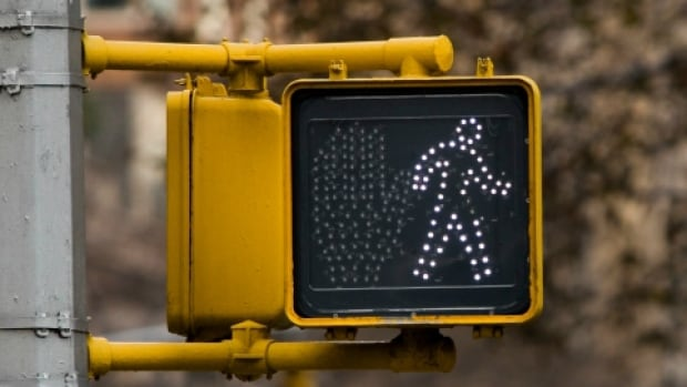 It's now mandatory for drivers and cyclists in the province to wait for pedestrians at some crosswalks to completely finish crossing the road.