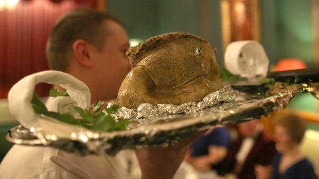 A chef carries a plate of haggis after a reading of the 'Address to the Haggis' during a Burns supper at the Royal Burgess Golfing Society in Edinburgh, Scotland on Jan. 24, 2013. Burns suppers are normally held on or near Jan. 25, which is the birthday of Scotlands's national poet, Robert Burns.