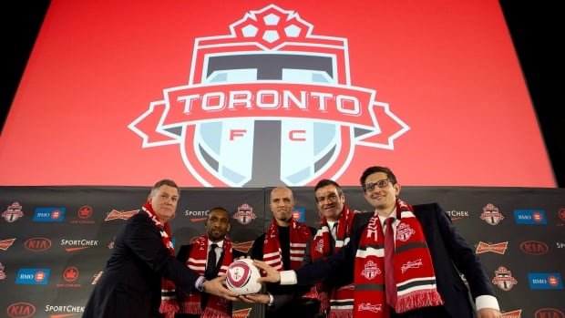 MLSE President and CEO Tim Lieweke, left to right, along with Toronto FC's new players Jermain Defoe and Michael Bradley with manager Ryan Nelsen and GM Tim Bezbatchenko pose for a photo at their introductory news conference in Toronto on Jan. 13.
