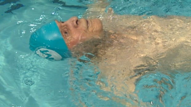 Jaring Timmerman swims in the 50-metre backstroke race at Winnipeg's Pan Am Pool on Friday night. Timmerman, who turns 105 next month, established two world swimming records and created a new category for competitors between the ages of 105 and 109.