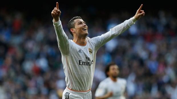 Real Madrid's Cristiano Ronaldo celebrates his goal against Granada at the Santiago Bernabeu stadium in Madrid, Spain, on Saturday.