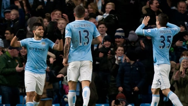 Manchester City's Sergio Aguero, left, celebrates with teammates after scoring the third of his three goals against Watford during their FA Cup match at The City of Manchester Stadium in Manchester, England on Saturday.