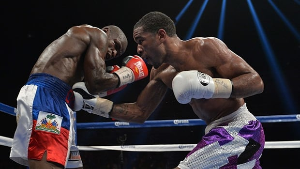 Canadian Dierry Jean, left, defends against Lamont Peterson during the bout at the DC Armory on January 25, 2014 in Washington, DC.