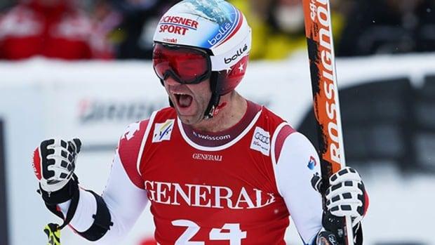 Didier Defago of Switzerland celebrates his win in the men's World Cup super-G event Sunday in Kitzbuehel, Austria.