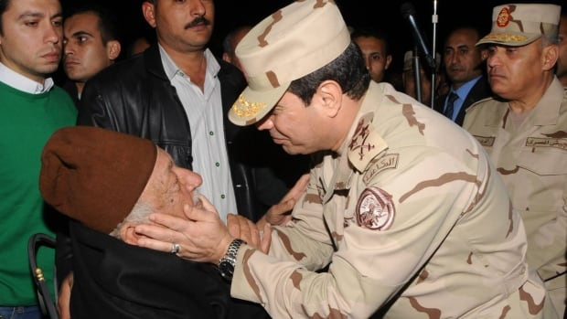 Egypt's army chief General Abdel Fattah al-Sisi, right, comforts the father of an officer who was killed in northern Sinai. Egypt will hold a presidential vote before parliamentary polls, President Adly Mansour announced on Sunday, in a change to a political roadmap which could pave the way for the swift election of Sisi.