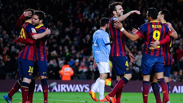 Barcelona players celebrate after a goal against Malaga CF at Camp Nou on January 26, 2014 in Barcelona, Spain.