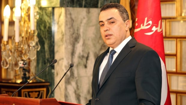Interim Prime Minister Mehdi Jomaa addresses the media after the new government presentation ceremony at the presidential palace in Carthage near Tunis, Sunday Jan. 26, 2014.