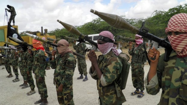 Al-Shabab fighters display weapons as they conduct military exercises in northern Mogadishu, Somalia in 2010.