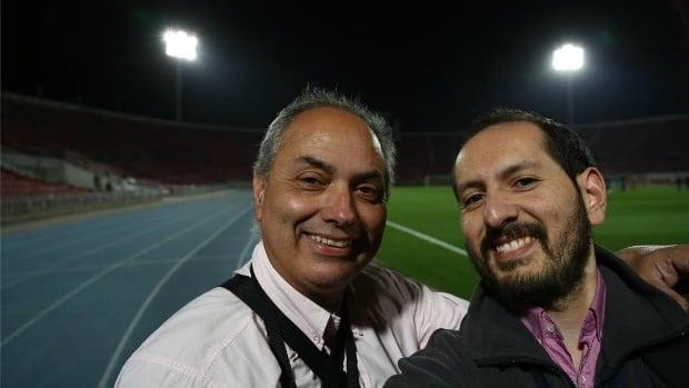 Tomas Urbina with his father Francisco, in Santiago's National Stadium in Chile.
