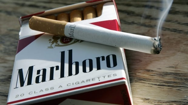 A Marlboro cigarette burns as it sits on a pack of Marlboro cigarettes in this January 2007 photo. Eric Lawson, an actor who once portrayed the Marlboro Man, has died of disease related to smoking.