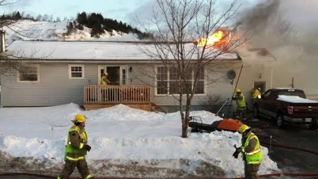 Springdale RCMP and members of the volunteer fire department were called to the scene of a house fire on Elm Street Monday morning.