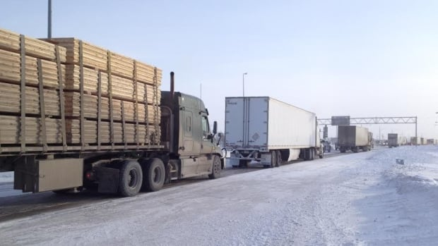 A long line of semi-trailers makes its way to Winnipeg on Monday morning after the Trans-Canada reopened. The highway was closed Sunday afternoon due to stormy conditions that made visibility extremely poor.