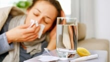 Woman sick in bed with cold or flu