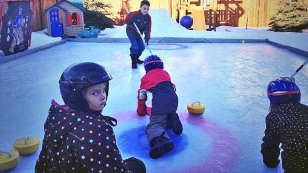 The Snider family enjoys winter by curling in their Calgary backyard.