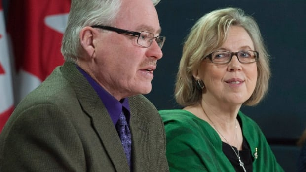 Green Party MP Bruce Hyer speaks at a press conference after being announced as the party's deputy leader by leader Elizabeth May, right, in Ottawa on Monday, Jan. 27, 2014.