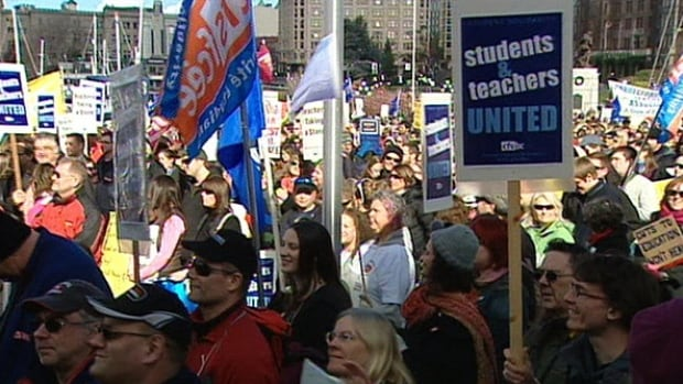Teachers stage rally against back to work legislation imposed under Bill 22, which  the B.C. Supreme Court ruled unconstitutional last week.