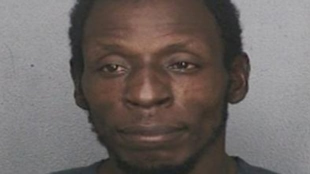 Twane Dobard, 37, reportedly surrendered to police in connection with the fatal stabbing of a Canadian tourist in Hollywood, Fla.