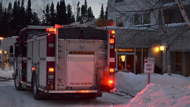 A fire truck sits outside of the Suomi Koti seniors home in Thunder Bay.