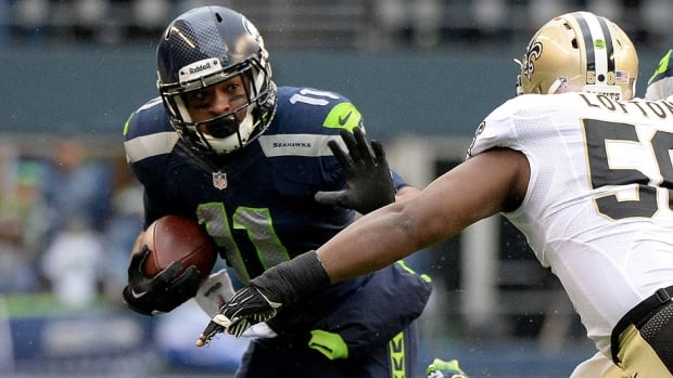 Seahawks wide receiver Percy Harvin, left, proclaims he's ready to play in Sunday's Super Bowl after suffering a concussion in Seattle's NFC divisional playoff game against New Orleans.