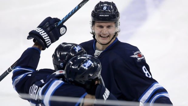 Winnipeg Jets' Jacob Trouba, Mark Stuart and Chris Thorburn celebrate Thorburn's goal during the first period against the Nashville Predators Tuesday at the MTS Centre.