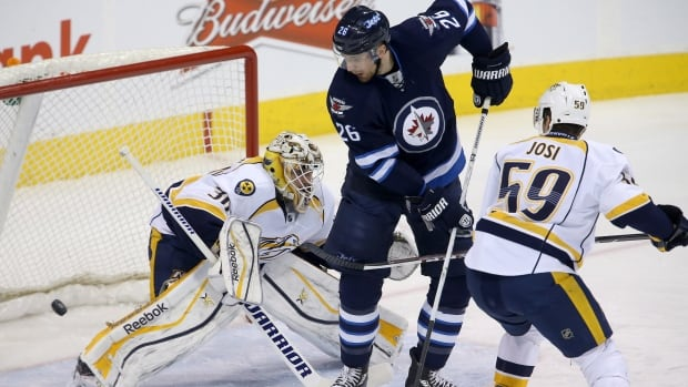 Blake Wheeler screens Nashville Predators goalie Carter Hutton during the first period of their game on Tuesday at the MTS Centre.