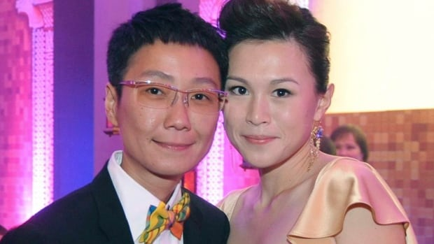 Gigi Chao, right, daughter of the Hong Kong property tycoon Cecil Chao, and her partner Sean Eav, left, eloped in France where they received a church blessing for their partnership.