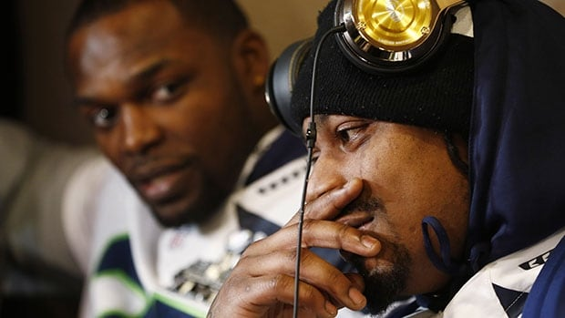 Marshawn Lynch sits in front of the assembled media during Wednesday's session at the Seahawks' hotel in Jersey City.