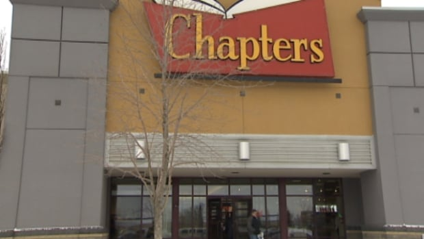 A man with a gun held up a woman in the parking lot of this strip mall in west Edmonton on Tuesday night.