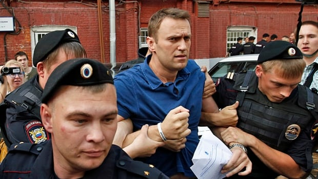 Police detain anti-corruption blogger Alexei Navalny in early July 2013 after he first attempted to register as a candidate for Moscow's mayoralty election. A driving force behind the large anti-Putin rallies in 2011, Navalny was subsequently convicted and quickly given a suspended sentence on what many have said were trumped up charges.