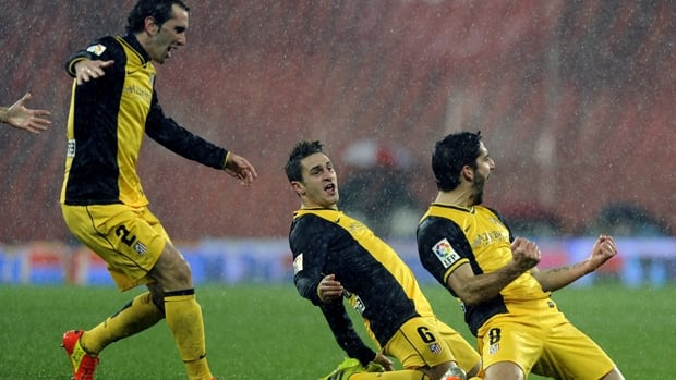 Atletico Madrid's Raul Garcia, right, celebrates a goal with teammates against Athletic Club Bilbao at the San Mames stadium in Bilbao on January 29, 2014.
