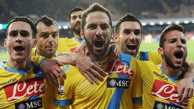 Napoli striker Gonzalo Higuain celebrates with teammates after scoring the game winning goal over Lazio in Naples, Italy on Wednesday.  The win pushes Lazio into the semifinals of the Italian Cup.
