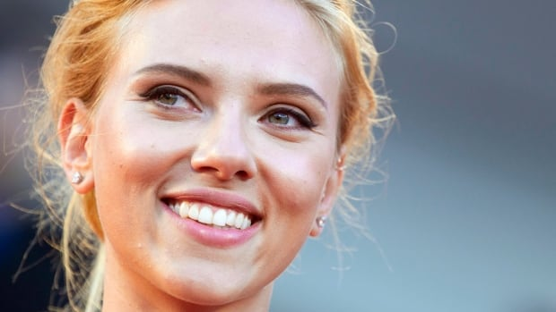 Actress Scarlett Johansson poses on the red carpet for the September 2013 screening of the film Under The Skin at the Venice Film Festival in Italy. Johansson is ending her relationship with Oxfam International after being criticized over her support for an Israeli company that operates in the West Bank.