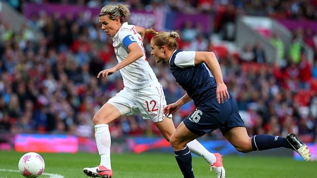 Canadian forward Christine Sinclair, left, is challenged by American defender Rachel Buehler during a matchup at the London 2012 Olympic Games.