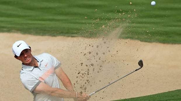 Rory Mcilroy plays a bunker shot on the third hole during the second round of the Dubai Desert Classic on Friday. He leads by one stroke over European Tour-based American Brooks Koepka.