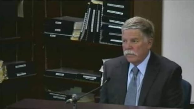 Engineer Robert Wood is seen testifying at the Elliot Lake Inquiry in June of 2013. In January, provincial police charged Wood with two counts of criminal negligence causing death and one of causing bodily harm.