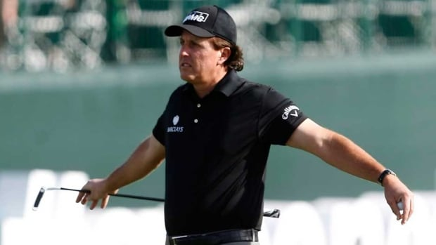 Phil Mickelson stretches on the 17th hole during the first round of the Waste Management Phoenix Open in Scottsdale, Ariz.