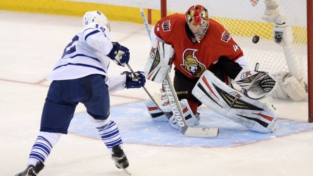 Toronto Maple Leafs' Mason Raymond scores a shoot-out goal on Ottawa Senators' Craig Anderson during NHL hockey action in Ottawa on Saturday, Dec. 7, 2013.