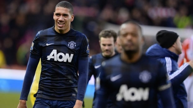 Manchester United's English defender Chris Smalling, left, reacts as he leaves the pitch after after losing to Stoke City at the Britannia Stadium in Stoke on Trent on Saturday.
