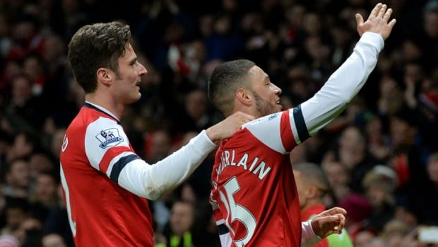 Arsenal midfielder Alex Oxlade-Chamberlain, right, celebrates after scoring his second goal against Crystal Palace at the Emirates Stadium in London on Sunday.