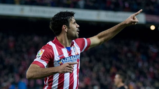Diego Costa of Atletico de Madrid celebrates scoring against Real Sociedad at Vicente Calderon Stadium on Sunday in Madrid, Spain.