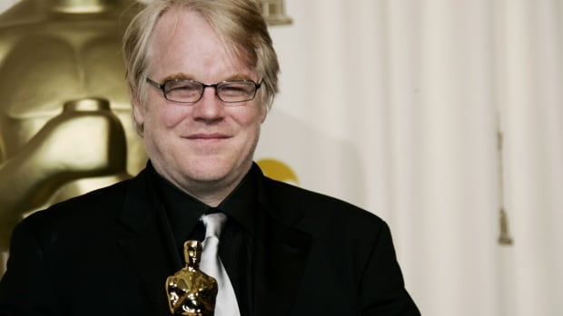 In this March 2006 photo, actor Philip Seymour Hoffman poses with the Oscar he won for best actor for his work in Capote. Police say Hoffman was found dead in his  apartment on Sunday. He was 46 years old.